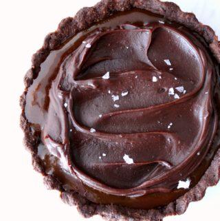 close up of chocolate caramel tart with flaked salt on top