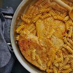 fusilli chicken pasta in pan with chicken