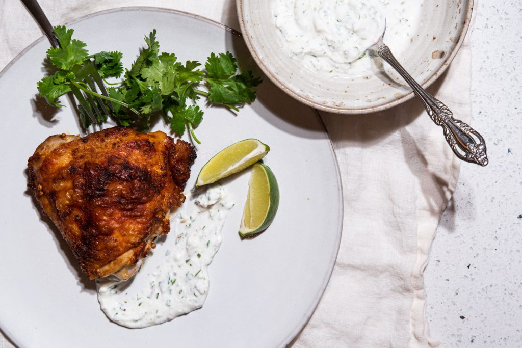 chicken thigh with yogurt sauce and cilantro