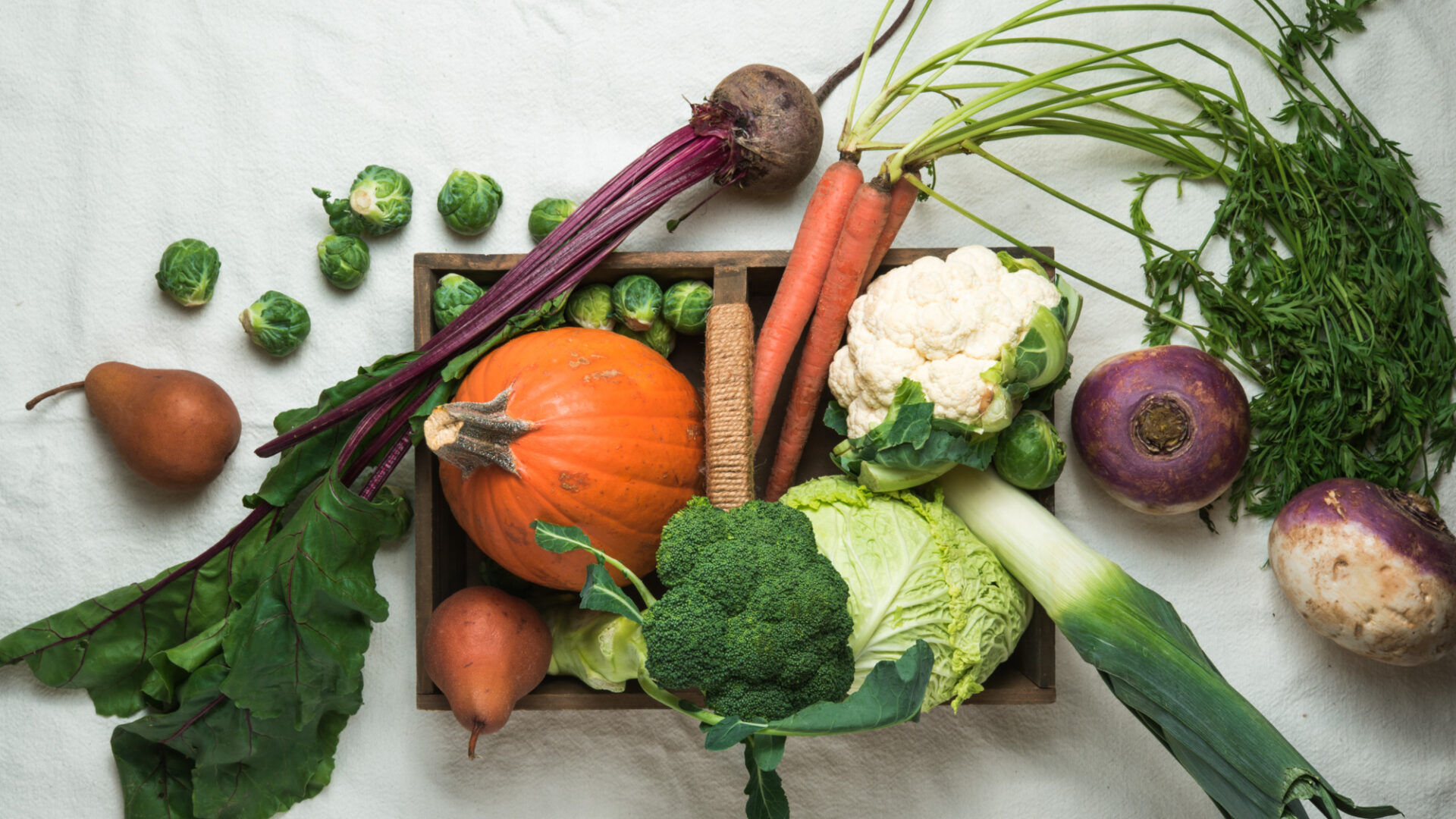 seasonal fall vegetables and fruit in a basket