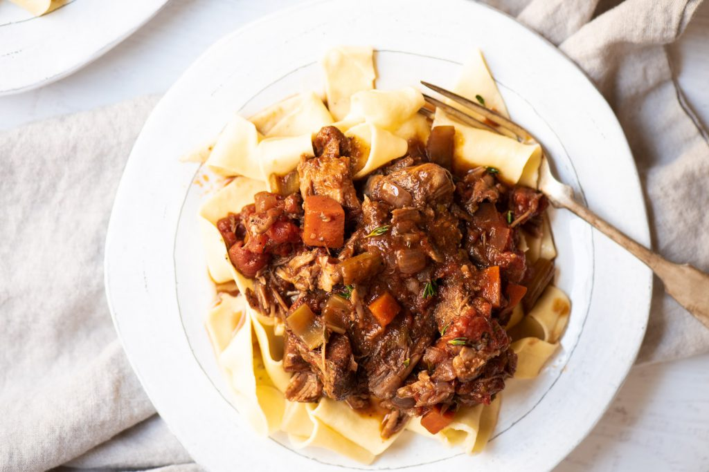 pork ragu braised over egg noodles