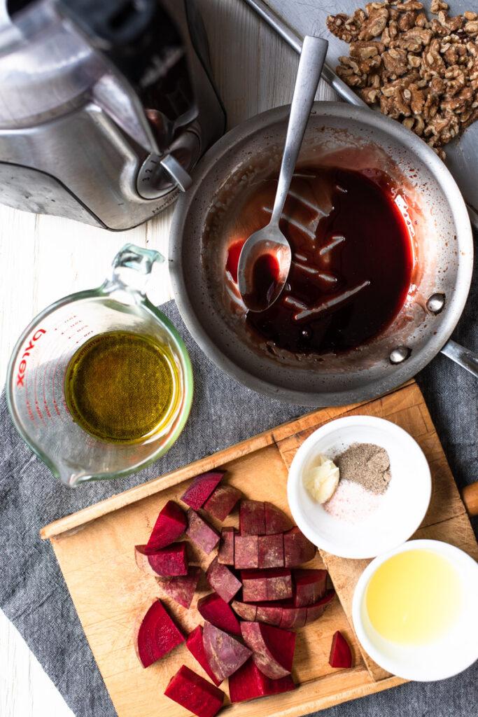 toasted walnuts, pomegranate molasses, olive oil, chopped beets, garlic, lemon juice, and salt